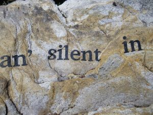 "letters on stone spelling ""an' silent in"""